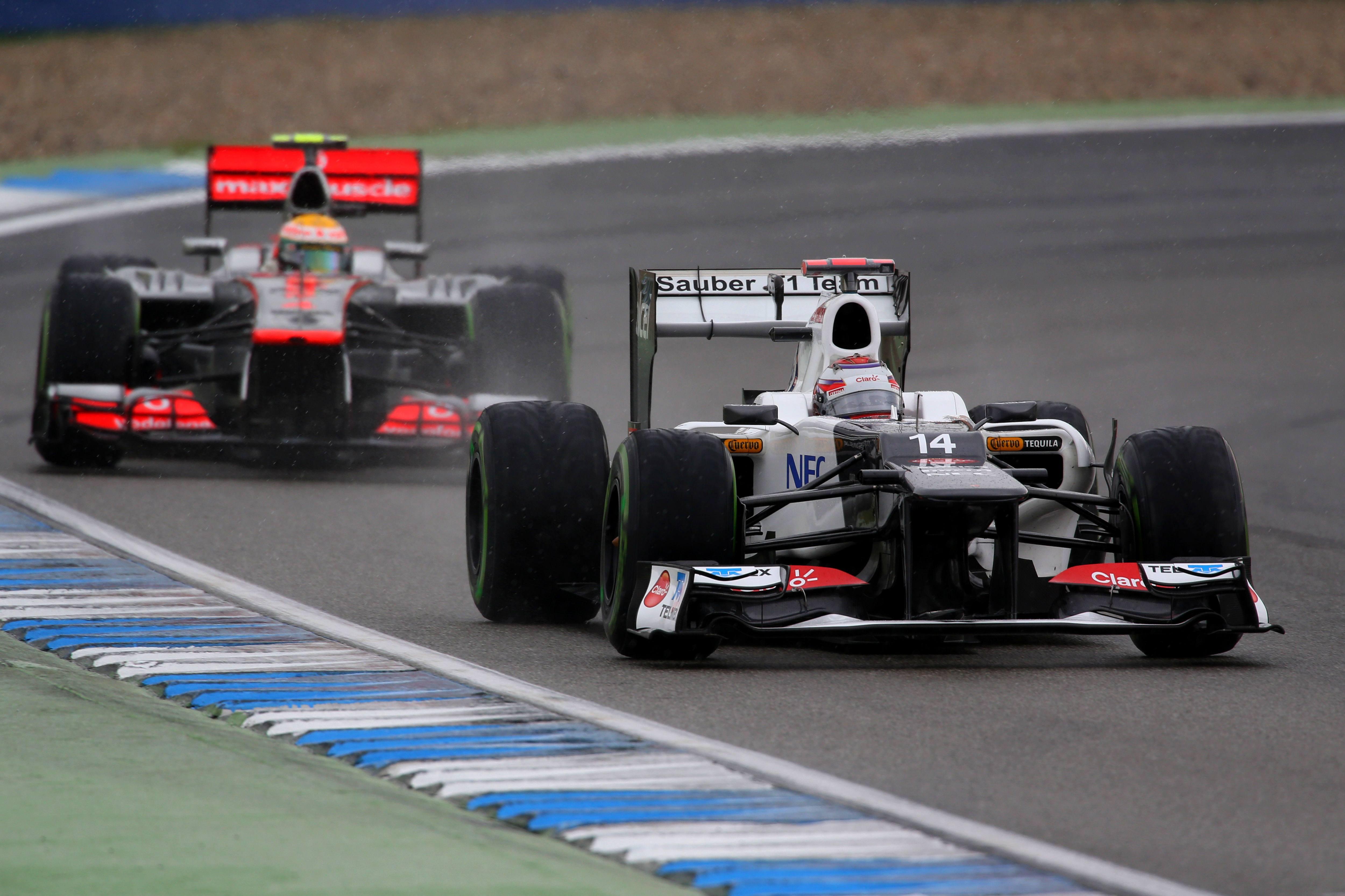 Kamui Kobayashi Lewis Hamilton